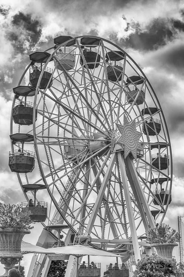 Vintage ferris wheel at Tibidabo Amusement Park, Barcelona, Catalonia, Spain. BARCELONA - AUGUST 12: Vintage ferris wheel attraction at Tibidabo Amusement Park stock photo