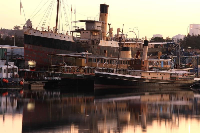 Vintage ferrys and tug retired at their moorings.