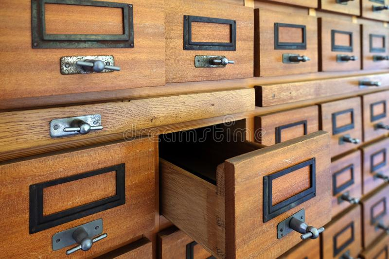 Vintage filing cabinet made of wood with one drawer open royalty free stock photos