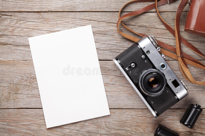Vintage film camera and blank photo frame stock image