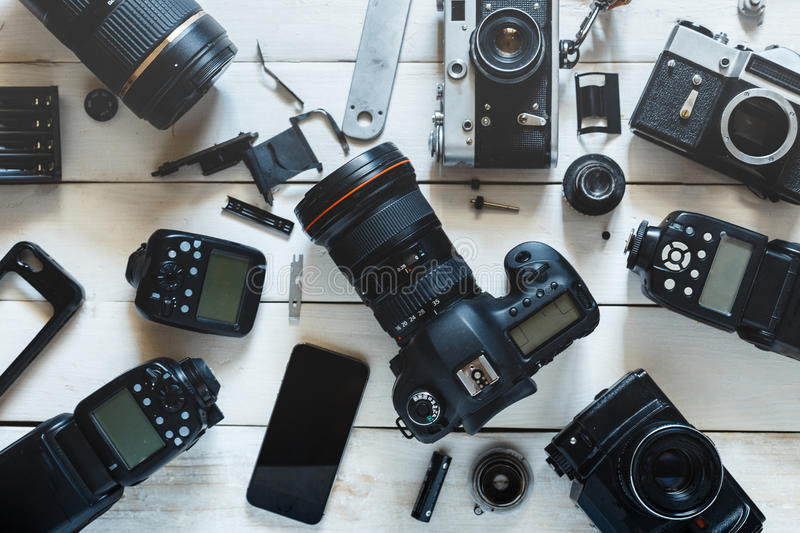 Vintage Film Camera, Digital Camera And Smartphone On White Wooden Background Technology Development Concept. Top View stock photos