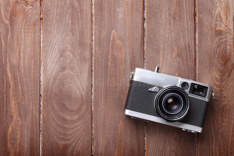Vintage film camera on wooden table royalty free stock photography