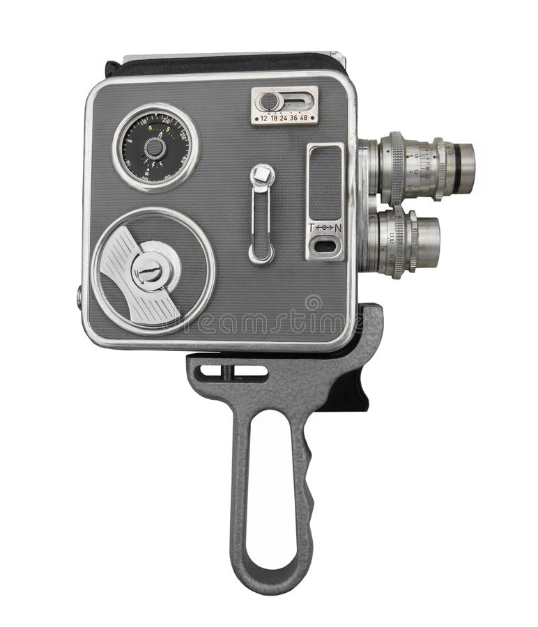 Vintage film movie camera isolated. Vintage film spring motor wound home movie camera with two lenses and handgrip. Isolated on white royalty free stock photos