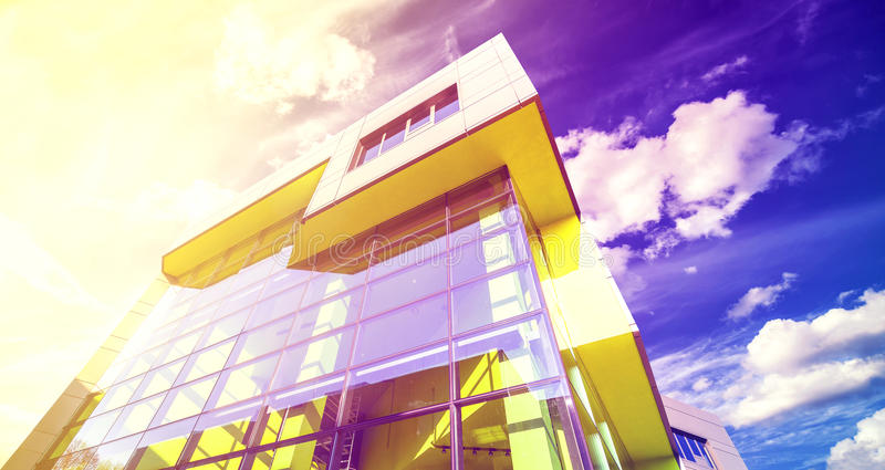 Vintage filtered photo of office building at sunset. stock image