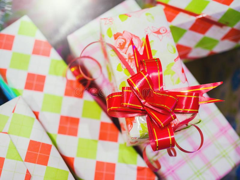 Vintage filtered on presents, gifts boxes with red bow.  royalty free stock images