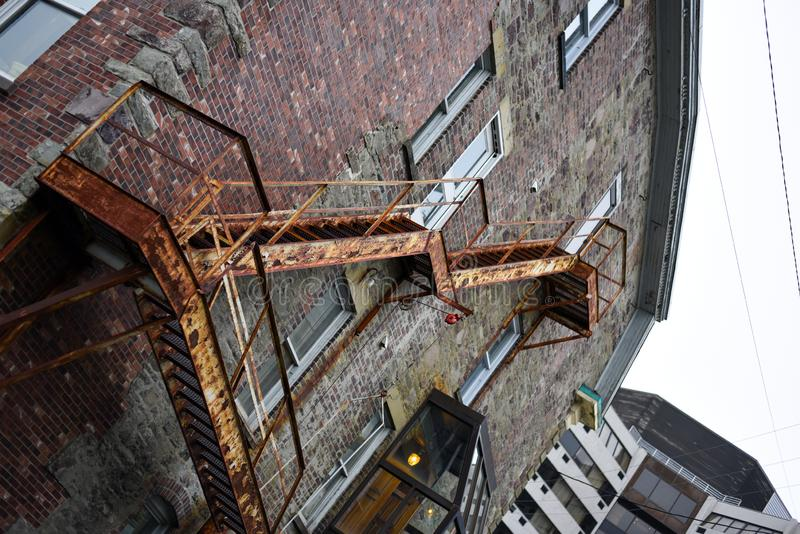 Vintage fire escape stairs on brick building royalty free stock image