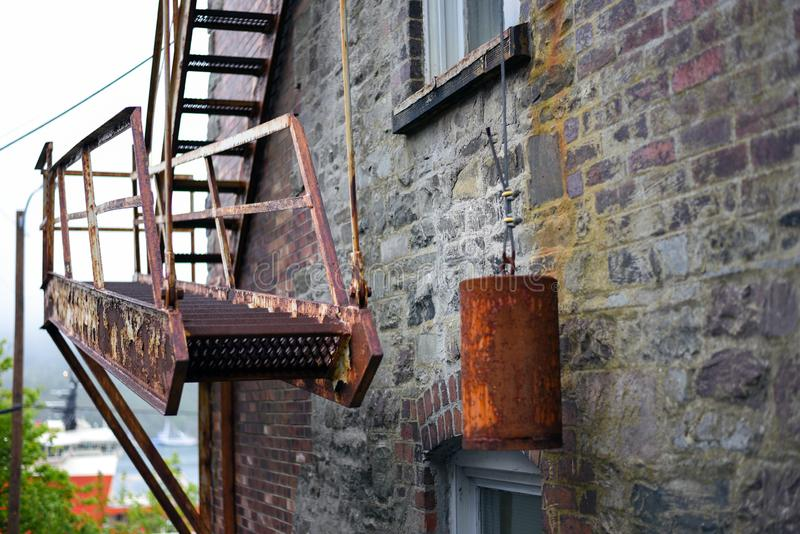 Vintage fire escape stairs with heavy weight stock photos