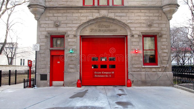 Vintage Firehouse in City bright red Doors & Brick wall stock photos