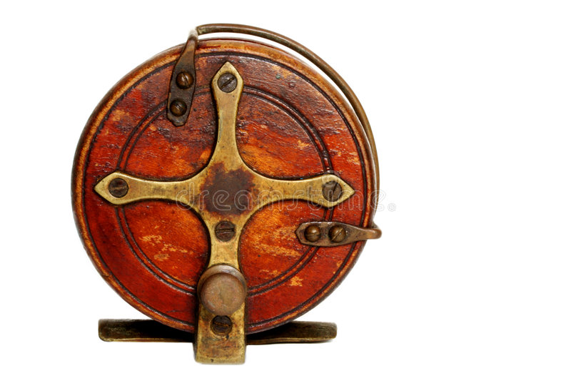 Vintage Fishing Reel. Vintage wooden fishing reel, isolated on white stock image