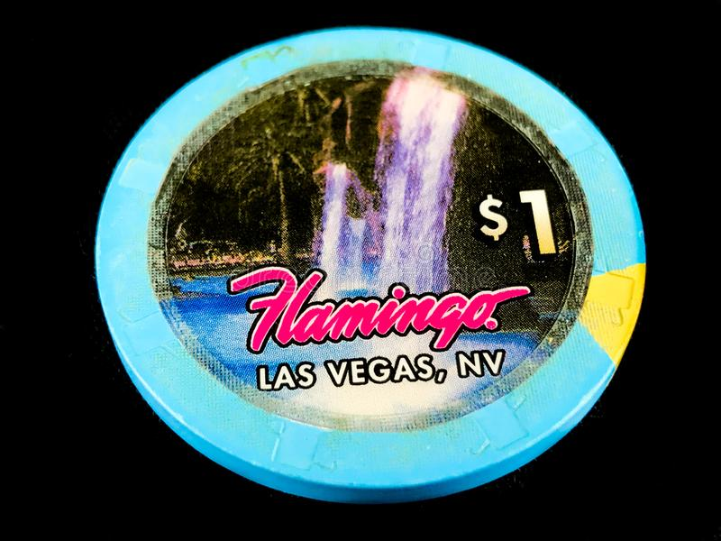 Vintage Flamingo Hotel & Casino $1 Poker Chip on a black backdrop royalty free stock images