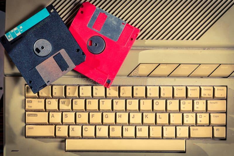 Vintage floppy disks and keyboard. Retro style stock photos