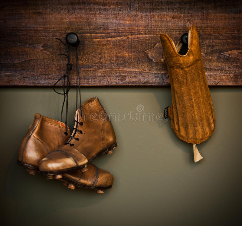 Vintage football boots and shin guard royalty free stock photo