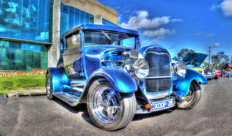 Vintage 1928 Ford Coupe. Vintage blue 1928 Ford Coupe hot rod with uncovered motor on display at car show in Melbourne Australia stock images