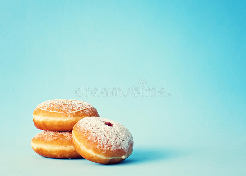 Vintage Frosted Donuts. Vintage donuts over blue background stock image