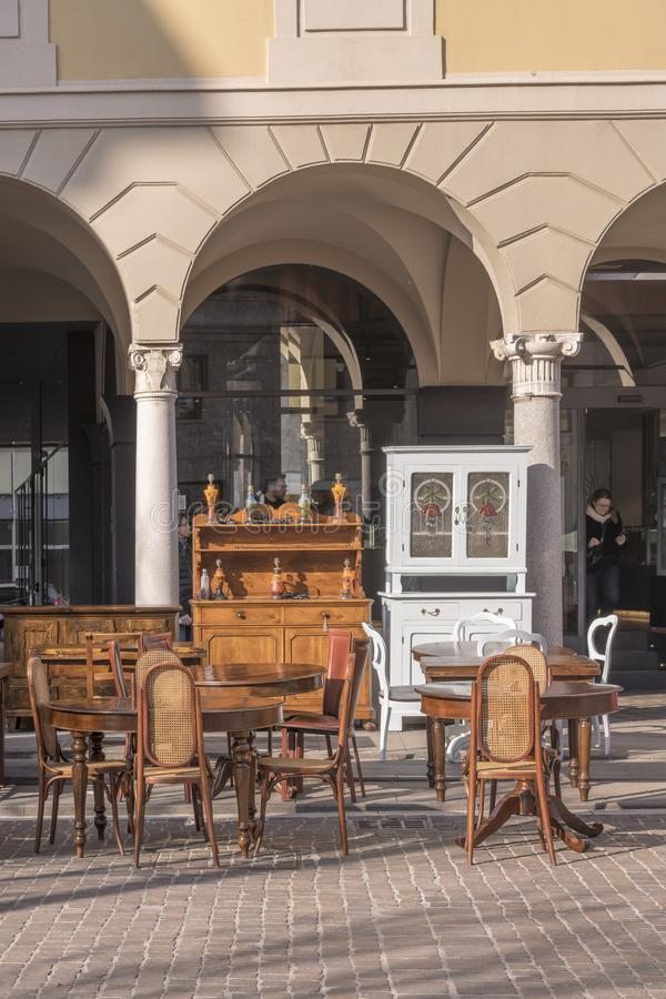 Vintage furniture on sale in street at flea market, Cremona, Italy royalty free stock image