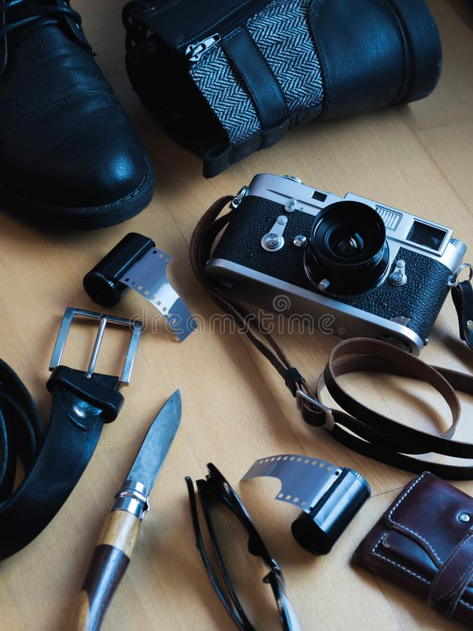 Vintage gear still life , shoes, belt, camera, sunglasses, wallet. Elegant, classic, leather, accessories, closeup, wooden, modern, pack, journey, traveler royalty free stock photo