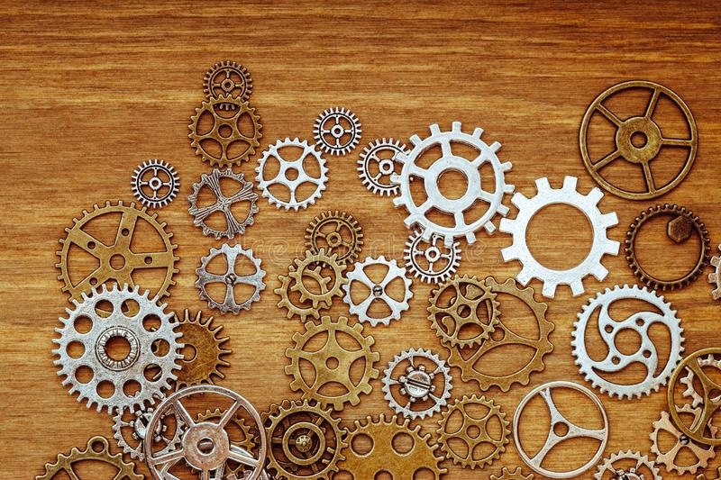 Vintage gear wheels on wooden background stock photo