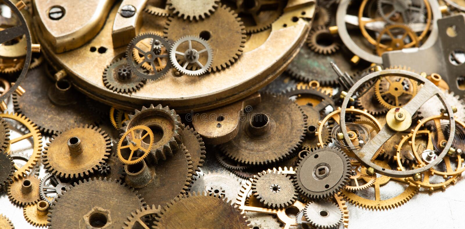 Vintage gears macro view. Aged mechanical clock wheels background. Shallow depth of field, soft focus.  royalty free stock photo