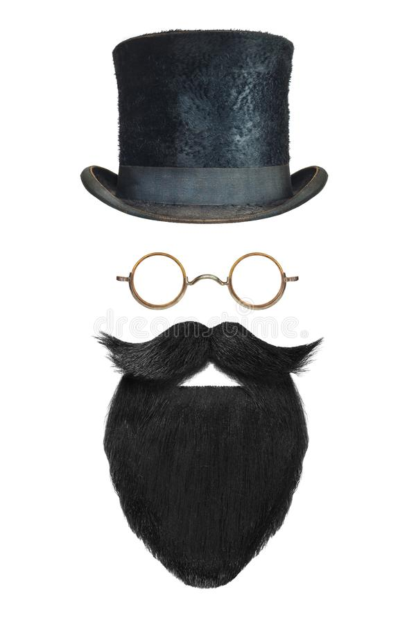 Vintage gentleman hat, glasses and black beard with curly mustac stock photo