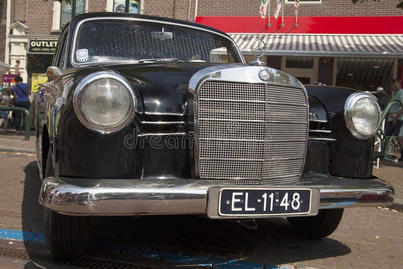 Vintage german mercedes 190. Medemblik, The netherlands - July 27,2014: Front view of a black mercedes 190 at the annual oldtimer show in Medemblik stock image