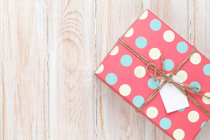 Vintage gift box over white wooden table royalty free stock photos