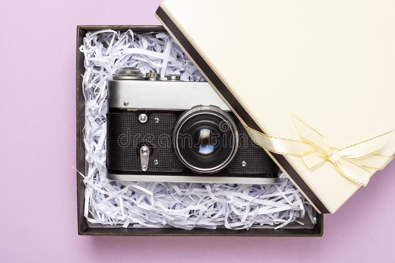 Vintage gift box on a pink background, top view.  stock images