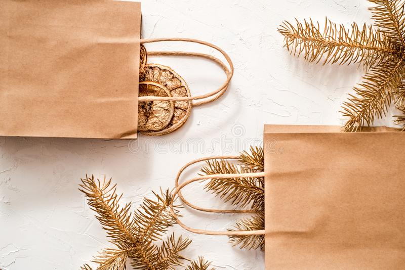 Vintage gift boxes in craft paper and a letter on white background. Presents decorated with natural parts. Christmas or other stock image