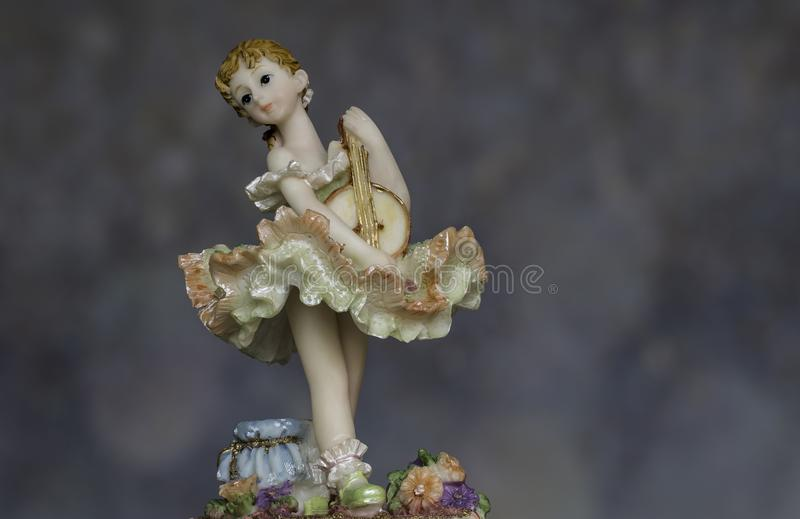 Vintage Girl Figurine wearing petticoat royalty free stock image