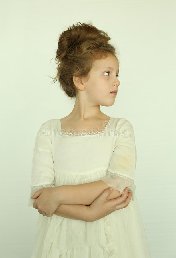 Vintage girl. Vintage looking little girl looking away from camera stock photography