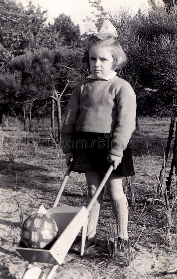 Free Vintage Girl With Wheelbarrow Stock Photo - 12632110