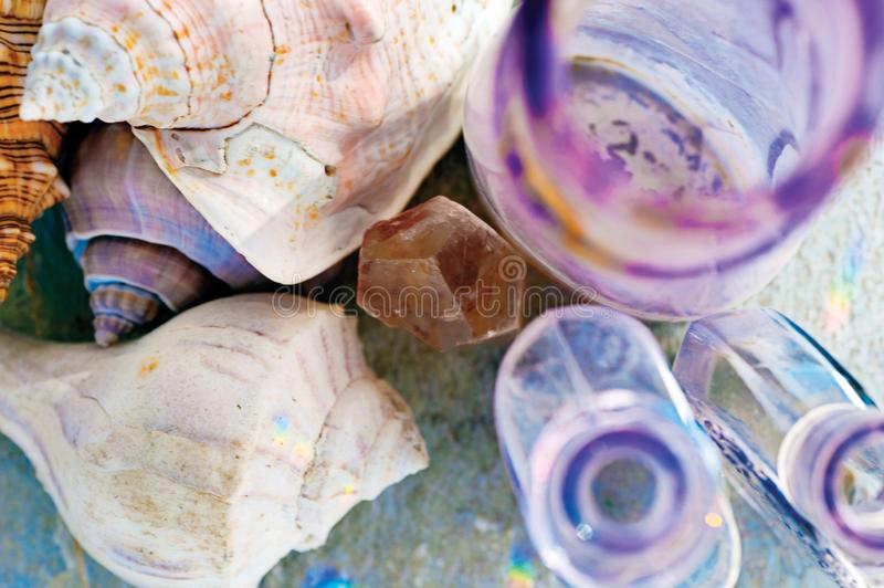 Vintage Glass Bottles and Seashells and Crystal royalty free stock images
