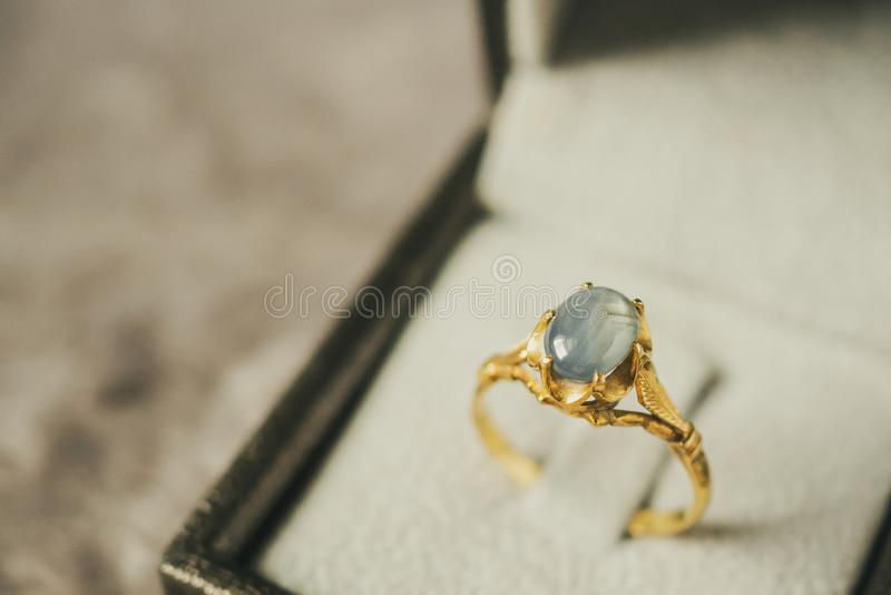 Vintage gold Jewelry blue sapphire ring stock photos