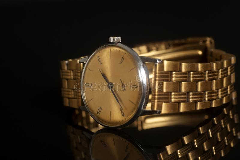 Vintage golden wrist watch stock image