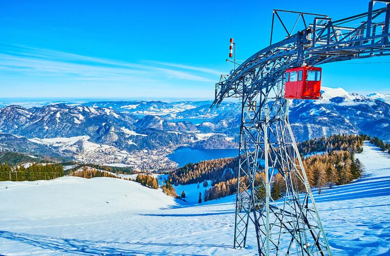 Vintage gondolas of Zwolferhorn air lift, St Gilden, Salzkammergut, Austria. The view from the top of Zwolferhorn mountain on the cable car tower, colorful royalty free stock images