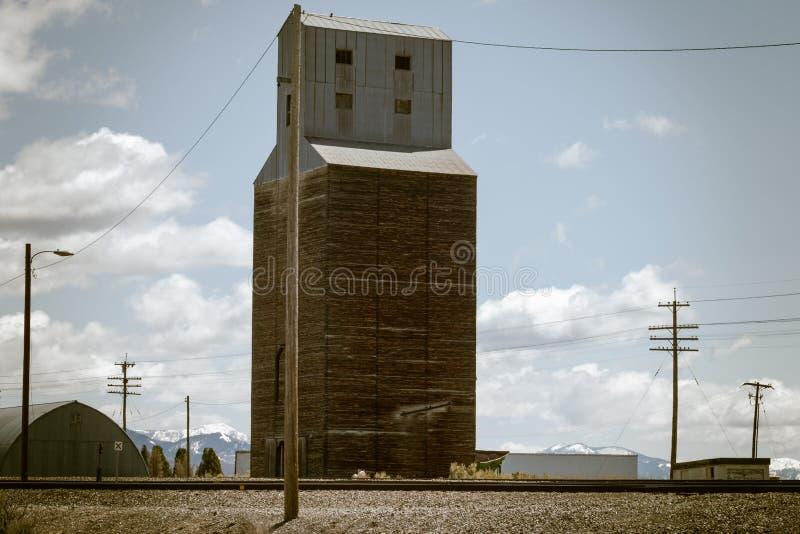 Vintage Grain Elevator Next to Railroad Tracks royalty free stock photos