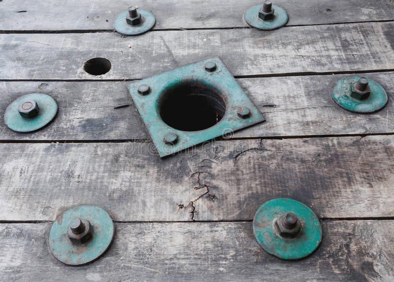 Vintage green bolt on vintage wood.  royalty free stock photo
