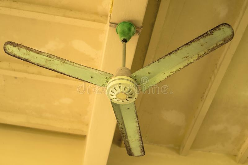 Vintage green ceiling fan on ceiling old ceiling fan with rust download vintage green ceiling fan on ceiling old ceiling fan with rust stock image mozeypictures Images