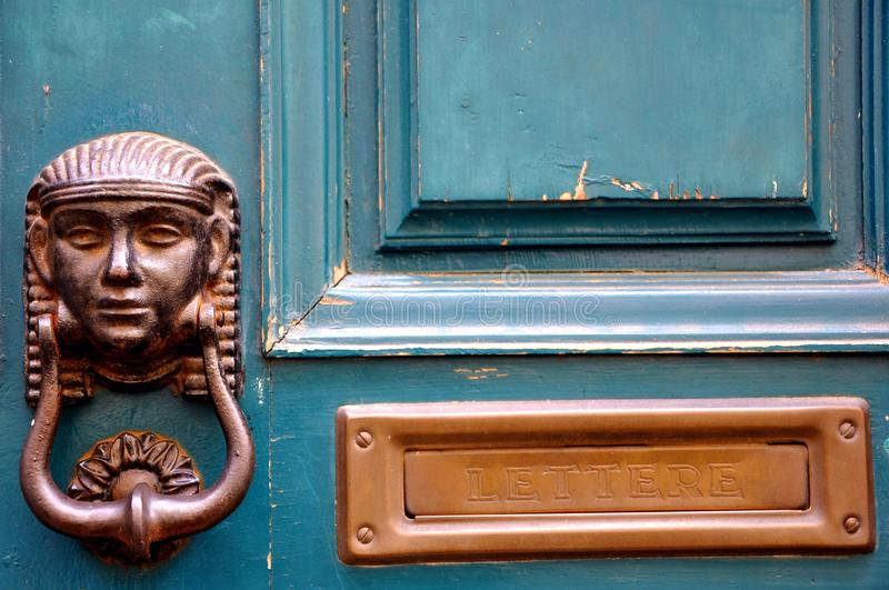 Vintage green door in Italy. Detail of an old green wooden door in Italy . brass knocker detail royalty free stock photography