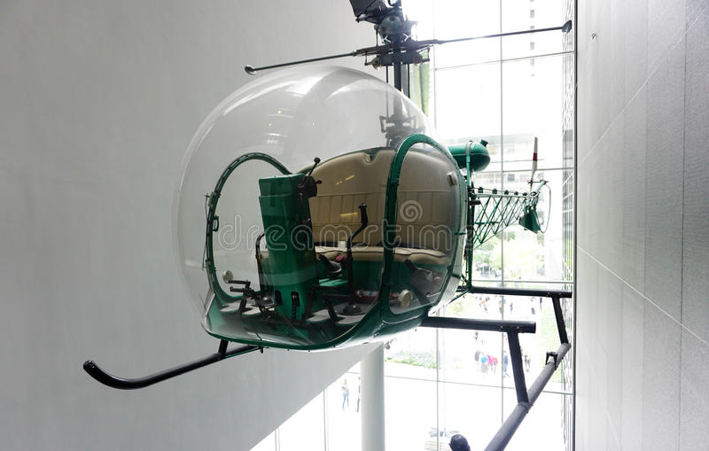 Vintage green helicopter on display. Inside building stock images