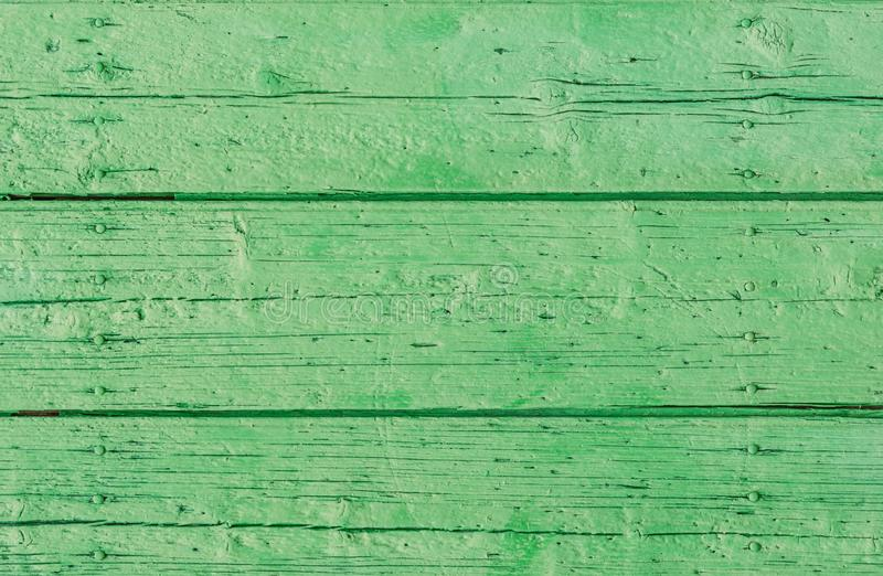 Old rustic green colored wood surface background texture stock photography