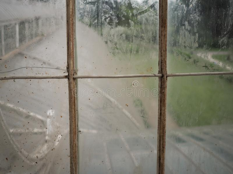 Dirty window panes of glass and metal royalty free stock photo