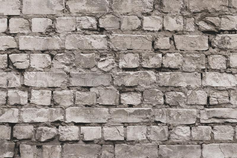 Vintage grey brick wall texture. White old cement wall background. Pattern with gray dilapidated bricks. Blank concrete grunge wal stock images