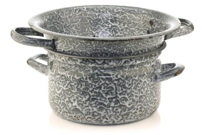 Vintage grey enamel cooking pan with colander stock photos