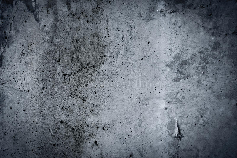 Vintage grey painted plaster concrete wall background. Dark edge royalty free stock photos