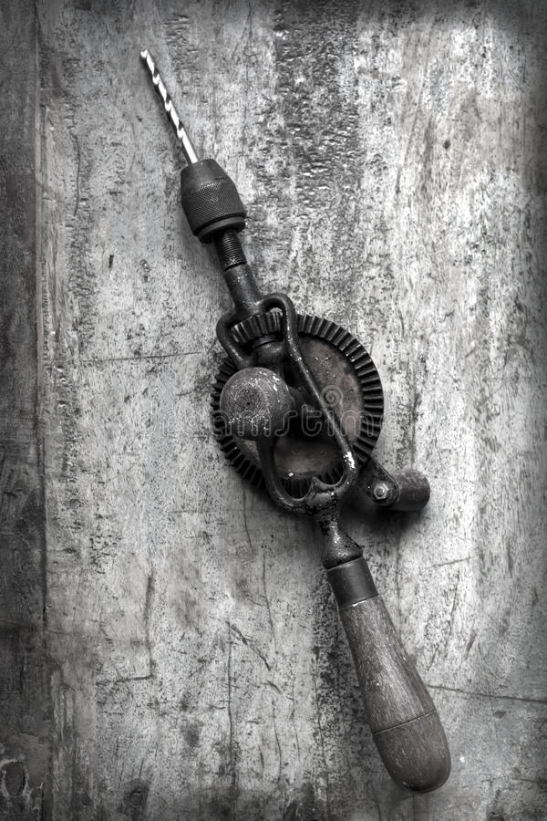 Vintage Hand Drill with Grunge Effects royalty free stock photography
