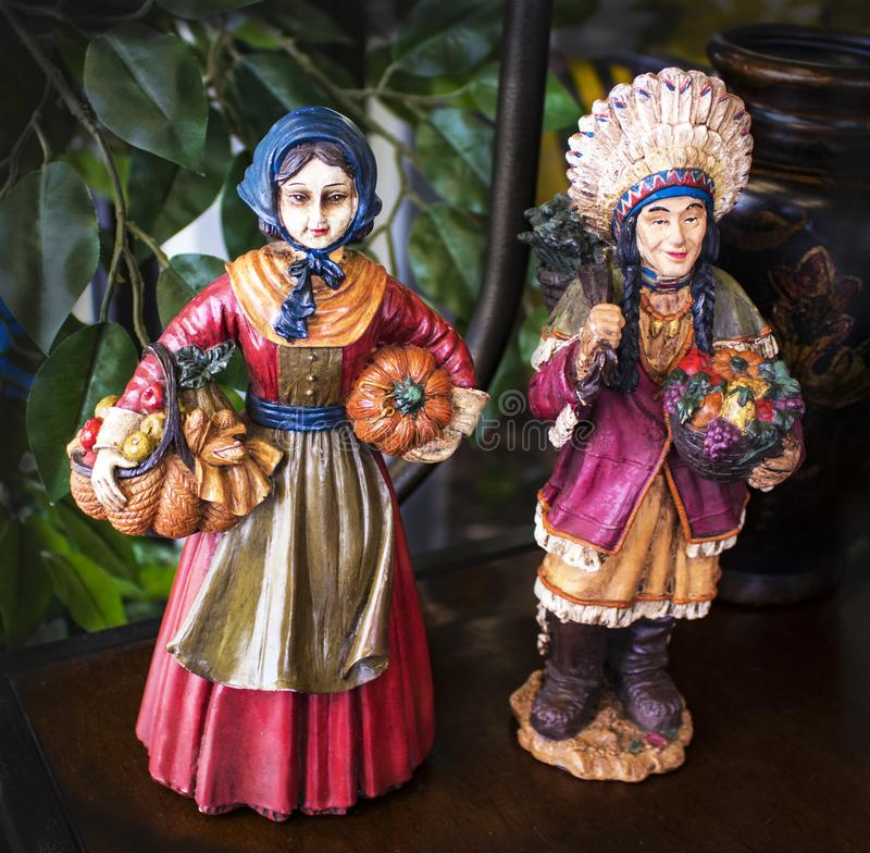 Vintage hand painted Pilgrim and Indian figurines for Thanksgiving stock images