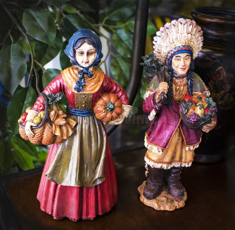 Vintage hand painted Pilgrim and Indian figurines for Thanksgiving stock photo