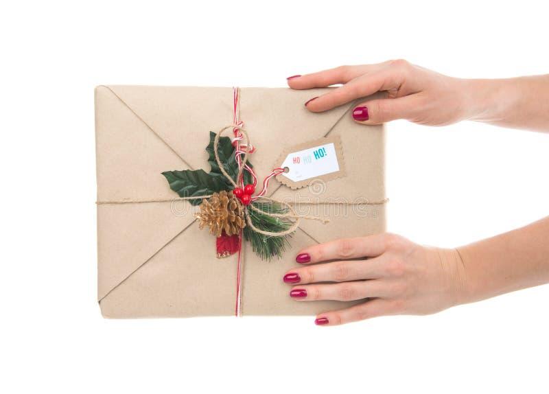 Vintage handmade craft christmas or birthday present in hands. Vintage handmade craft christmas or rustic birthday present gift in hands isolated on a white stock image