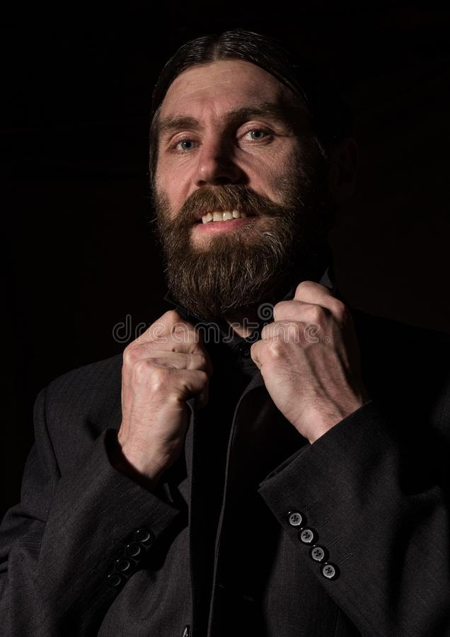 Vintage handsome bearded man. severe man on a dark background. free space for your text royalty free stock photo