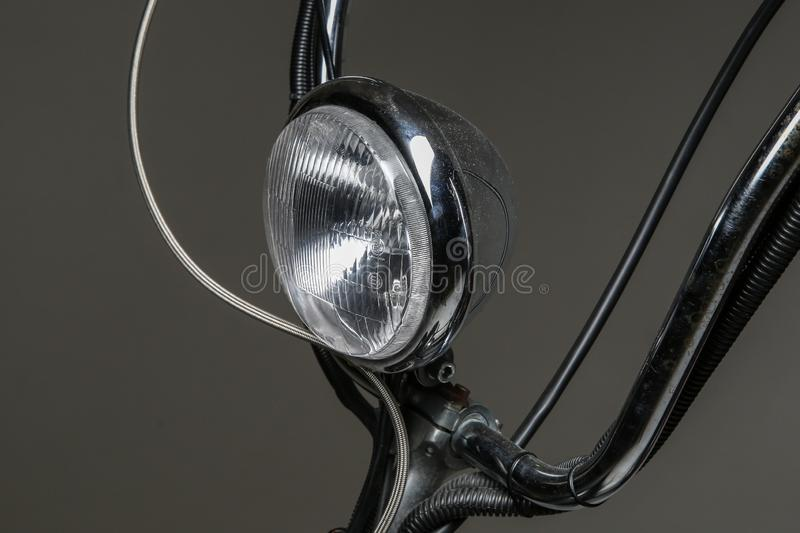 Vintage headlight on the handlebar of an old scooter stock photography